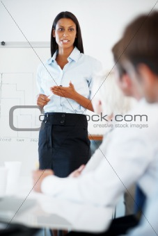 Young businesswoman discussing project with colleagues