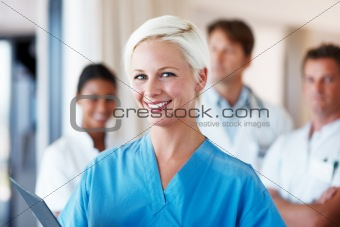 Happy young female nurse smiling at hospital
