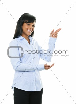 Smiling young woman pointing