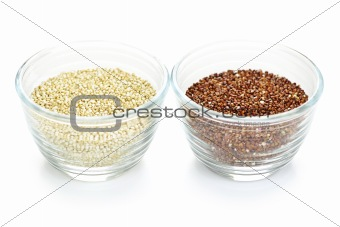 Red and white quinoa grain in bowls