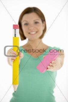 Woman Holding Big Pencil And Eraser