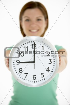 Woman Holding Clock Showing 9 O'Clock