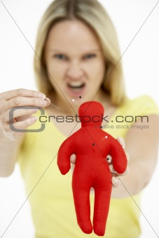 Woman Holding Voodoo Doll