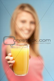 Teenage Girl Holding Glass Of Juice