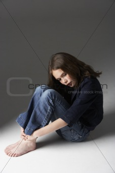 Thoughtful Girl Sitting In Studio