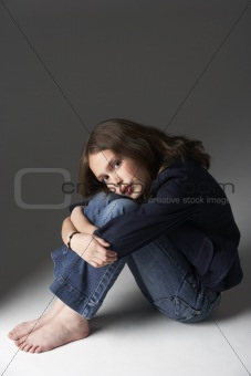 Thoughtful Girl Sitting In Studio