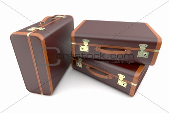 Three brown vintage suitcases