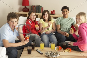 Group Of Children Eating Burgers At Home