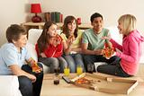 Group Of Children Eating Pizza At Home