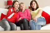 Group Of Three Girls Watching TV