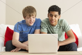 Two Boys Using Laptop At Home
