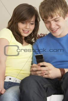 Teenage Couple Reading Text Message