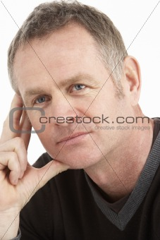Portrait Of Thoughtful Middle Aged Man