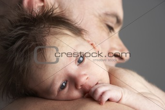 Father Hugging Newborn Baby
