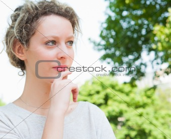 beautiful young attractive woman outdoors portrait of thinking w