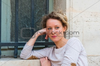 beautiful attractive young woman standing by white wall 