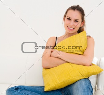 beautiful smile young woman with green pillow