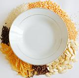 dish with vegenables around on a white background