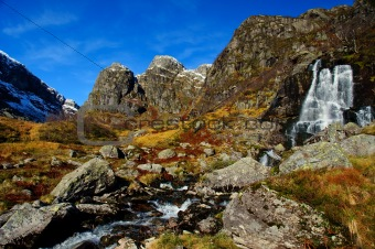 Waterfall in autumn mountains