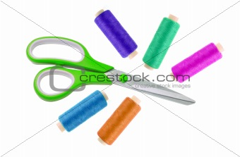 Green metal scissor and colorful sewing threads isolated on whit