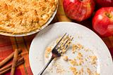 Overhead Abstract of Apple Pie, Empty Plate with Remaining Crumbs and Fork.