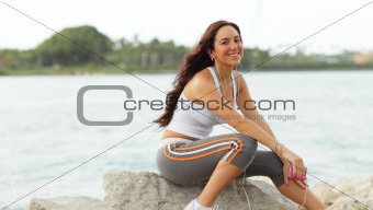 Attractive woman sitting on the rocks