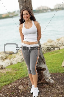 Fitness model leaning on a tree
