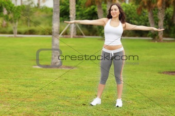 Fitness model stretching in the park