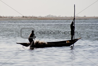 Fishermen in a pirogue in the river Niger.