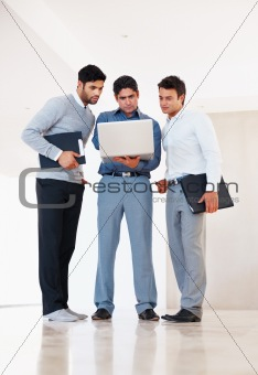 Three business men at work