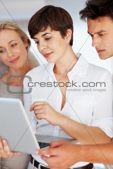 Executives working on laptop