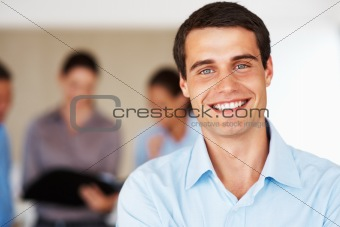 Young male executive smiling