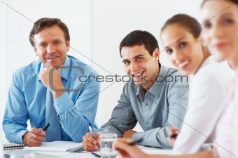 Mature business man smiling during meeting