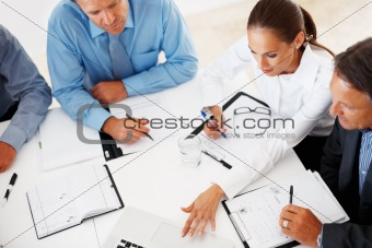 Executives using laptop in meeting