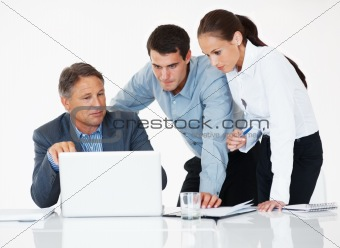 Business colleagues using laptop