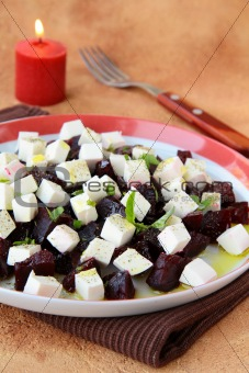 appetizer salad of beets and goat cheese with basil and olive oil