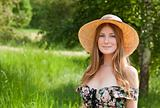 Young beautiful girl with hat posing outdoor