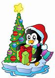 Cartoon penguin with Christmas tree