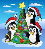 Christmas scene with three penguins
