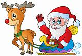 Santa Claus with sledge and deer