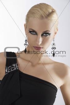 portrait of blond girl in black dress
