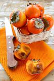 persimmon fruit on wooden table
