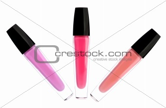 lipsticks (lipgloss) of pink color isolated on white background