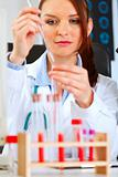 Medical doctor woman conducting tests in laboratory