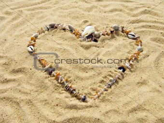 Heart from cockleshells and sea pebbles