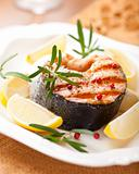 Grilled salmon steak with lemons