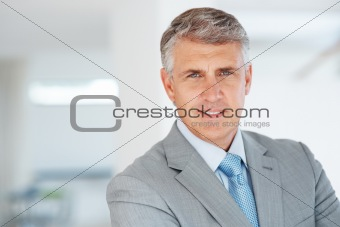 Confident senior business man at office