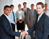 International business meeting two executives shaking hands