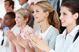 Business woman with colleagues applauding at a seminar