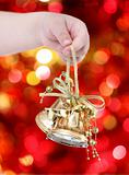 Child holding golden Christmas tree decorations